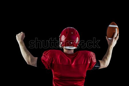 Rear view of american football player triumphing  Stock photo © wavebreak_media