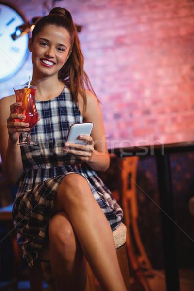 Portrait of two young women having cocktail drinks Stock photo © wavebreak_media