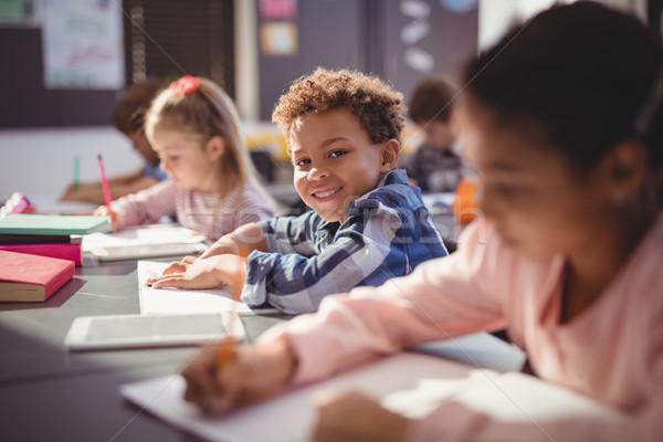 肖像 笑みを浮かべて 男子生徒 宿題 教室 学校 ストックフォト © wavebreak_media