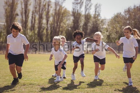 Group of women playing tug of war during obstacle course training Stock photo © wavebreak_media