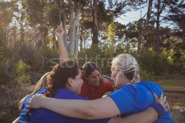 Group of fit women forming huddles in the boot camp Stock photo © wavebreak_media