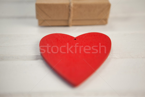 Heart shape by gift box on white table Stock photo © wavebreak_media
