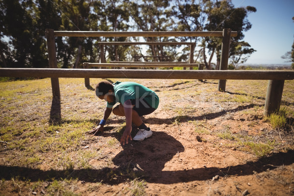 Determined boy crossing obstacle during obstacle course Stock photo © wavebreak_media
