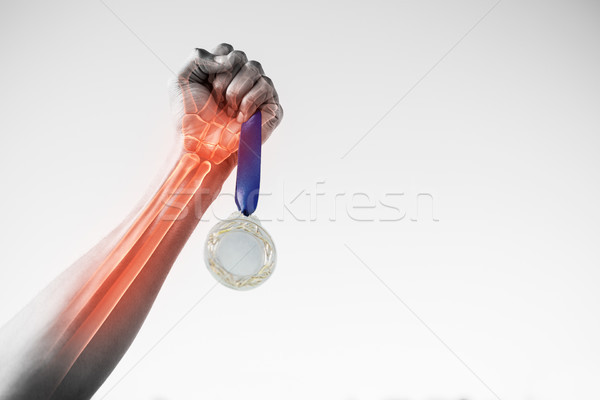 Cropped hand of sportsperson holding gold medal Stock photo © wavebreak_media