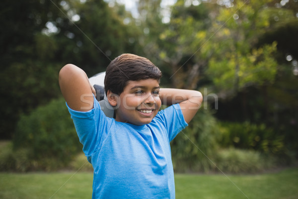 Mosolyog fiú tart futballabda park mögött Stock fotó © wavebreak_media