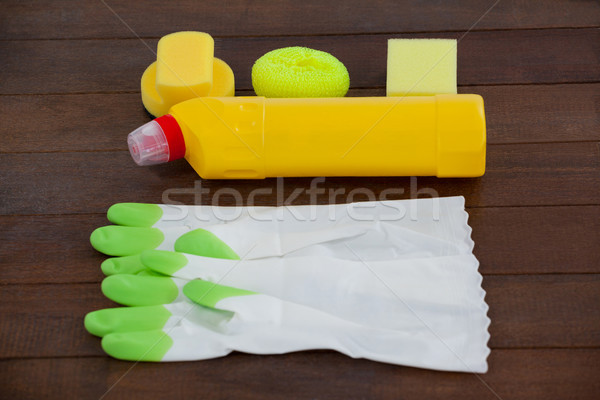 Cleaning equipment arranged on wooden floor Stock photo © wavebreak_media