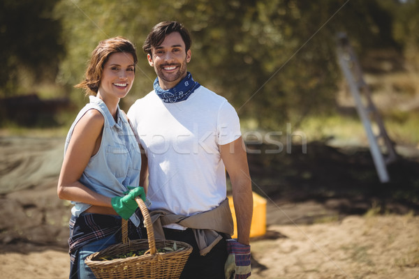 Smiling young couple holding wicker basket at olive farm Stock photo © wavebreak_media