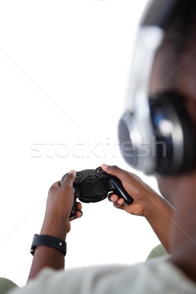Homem jogar jogo vídeo branco tecnologia Foto stock © wavebreak_media