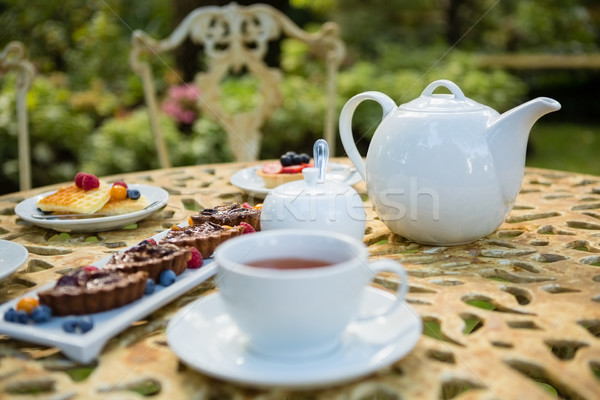 Cup of tea with dessert and teapot on table Stock photo © wavebreak_media