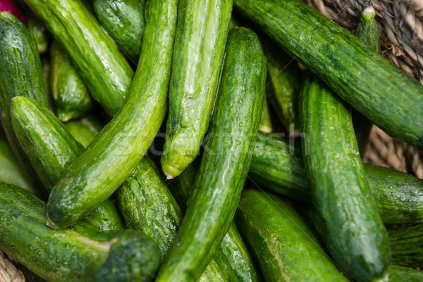 Fresh cucumbers in wicker basket Stock photo © wavebreak_media