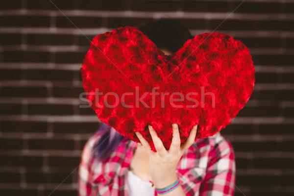 Woman hiding face from heart shape Stock photo © wavebreak_media