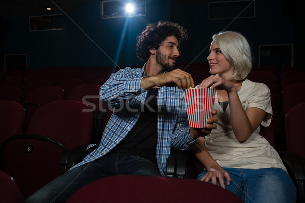 Loving couple looking at each other while sitting in the theatre Stock photo © wavebreak_media