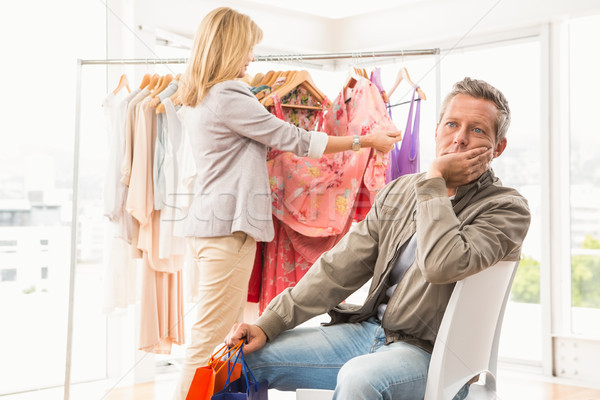 Bored man waiting for his shopping woman Stock photo © wavebreak_media