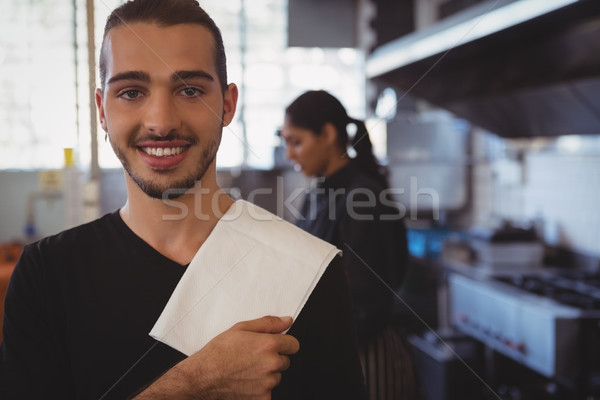 Portrait of waiter by coworker in cafe Stock photo © wavebreak_media