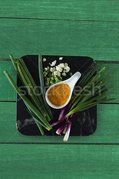 Scallions and turmeric on board Stock photo © wavebreak_media