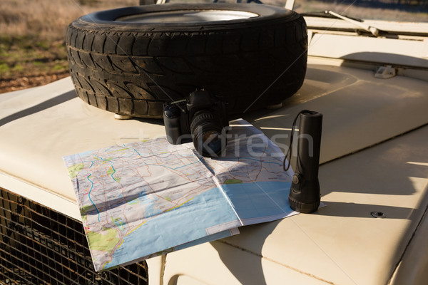 Spare tire with map on vehicle hood Stock photo © wavebreak_media