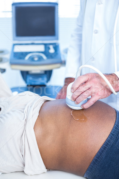 High angle view of male doctor performing ultrasound on woman  Stock photo © wavebreak_media