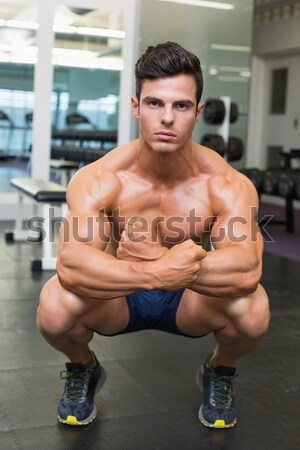 Muscular serious man doing weightlifting Stock photo © wavebreak_media