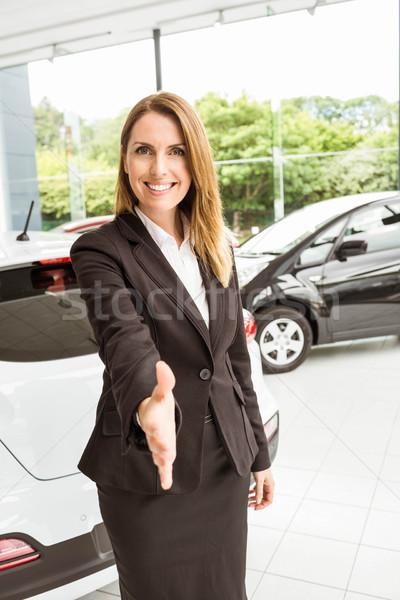 Smiling saleswoman ready to shake hand Stock photo © wavebreak_media