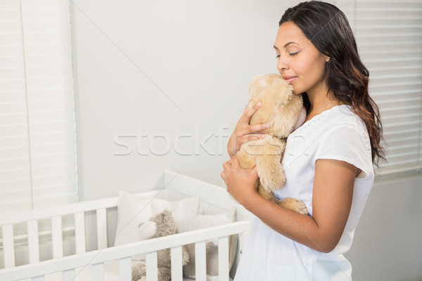 Souriant brunette peluche chambre portrait Photo stock © wavebreak_media