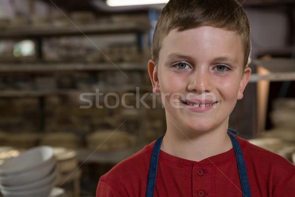 улыбаясь мальчика Керамика семинар портрет краской Сток-фото © wavebreak_media