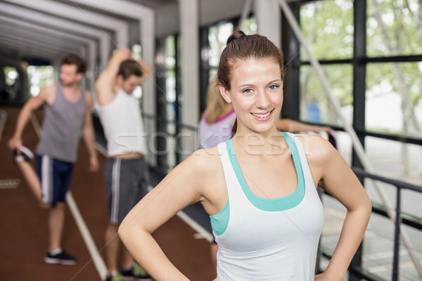 Smiling athletic woman posing with hands on hips  Stock photo © wavebreak_media