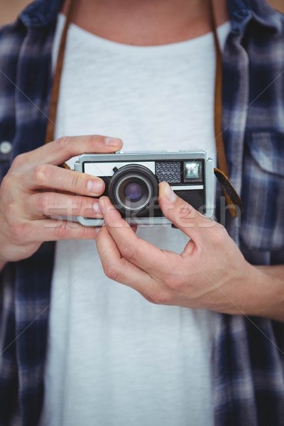 View of masculine hands holding a retro camera Stock photo © wavebreak_media