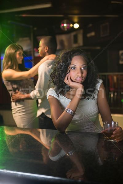 Boldogtalan nő ül bár pult pár Stock fotó © wavebreak_media