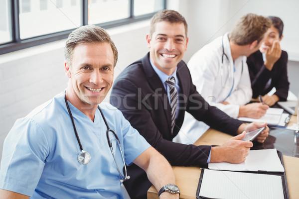 портрет врачи улыбаясь конференц-зал счастливым больницу Сток-фото © wavebreak_media