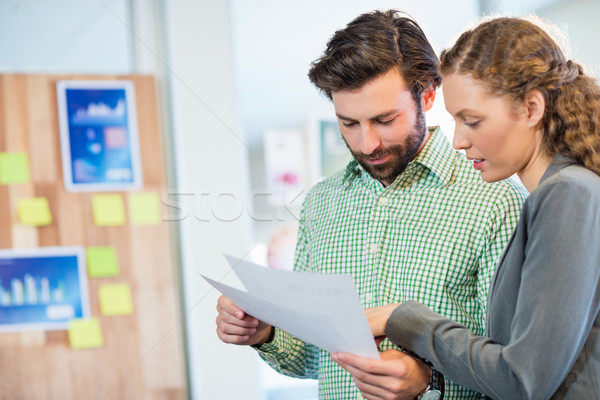 Businessman and businesswoman looking at diary Stock photo © wavebreak_media