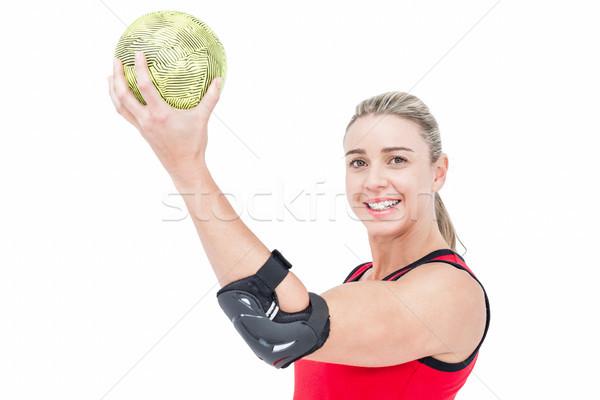 Female athlete with elbow pad holding handball Stock photo © wavebreak_media