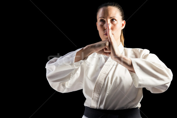 Female fighter performing hand salute Stock photo © wavebreak_media