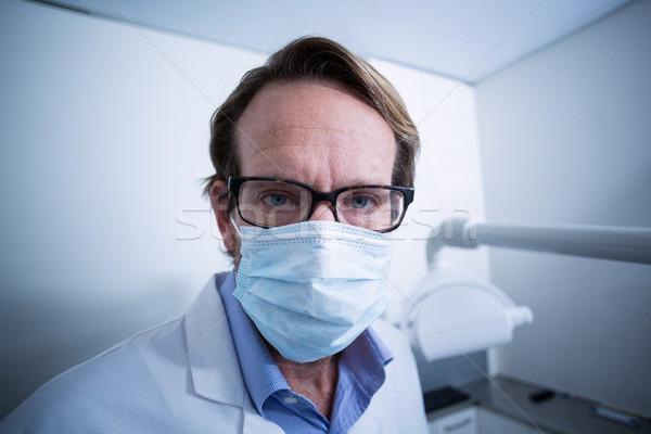 Retrato dentista máscara cirúrgica clínica homem Foto stock © wavebreak_media