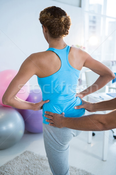 Physiotherapist examining womans back  Stock photo © wavebreak_media