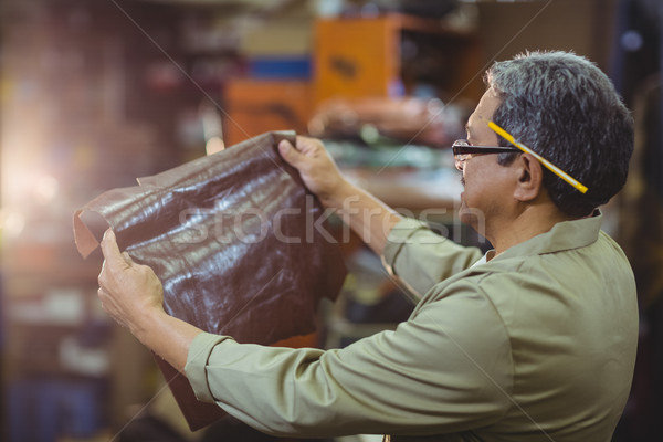 Shoemaker examining a piece of leather Stock photo © wavebreak_media