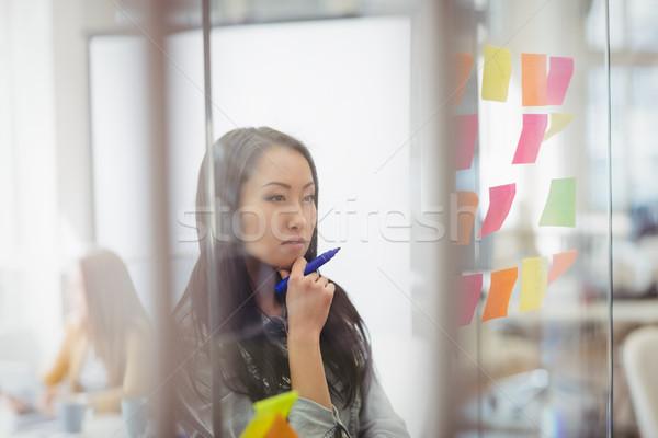 Foto editor olhando notas Foto stock © wavebreak_media