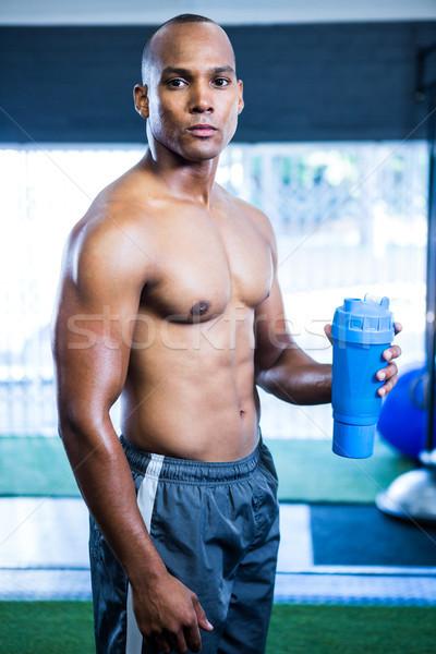 мышечный рубашки спортсмена бутылку портрет Сток-фото © wavebreak_media