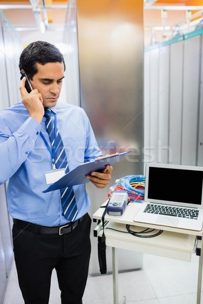 Technician talking on mobile phone Stock photo © wavebreak_media
