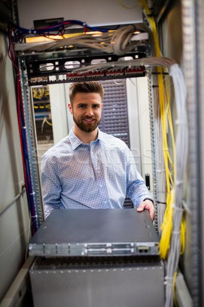 Technician removing server from rack mounted server Stock photo © wavebreak_media