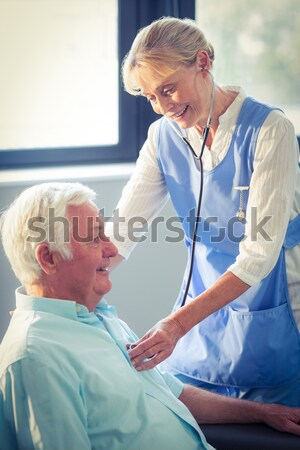 Doctor placing an oxygen mask on the face of a patient Stock photo © wavebreak_media