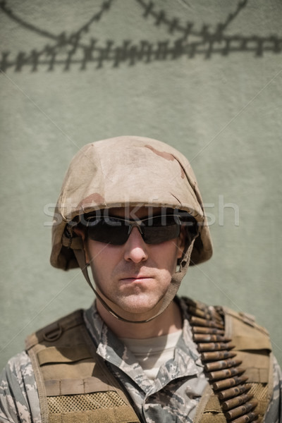Close-up of confident military soldier standing against concrete wall Stock photo © wavebreak_media