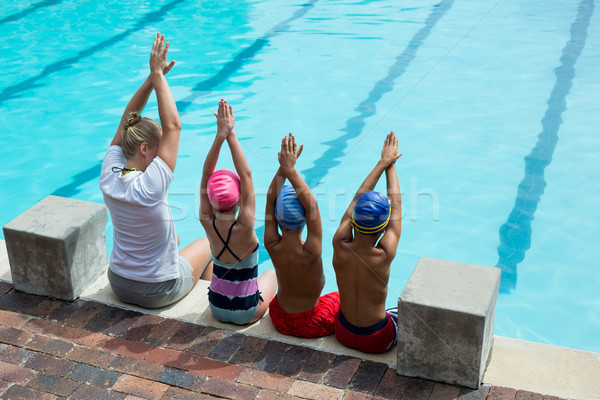 Female swimming instructor with students at pool side Stock photo © wavebreak_media