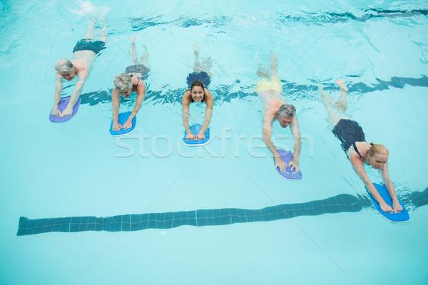 Idős edző úszik medence nő víz Stock fotó © wavebreak_media