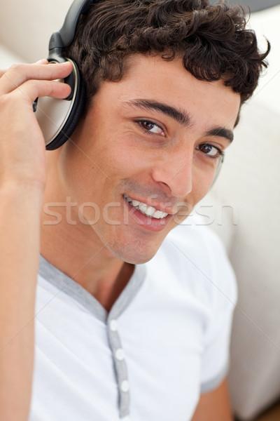 肖像 代 男 音楽を聴く ヘッドホン 幸せ ストックフォト © wavebreak_media