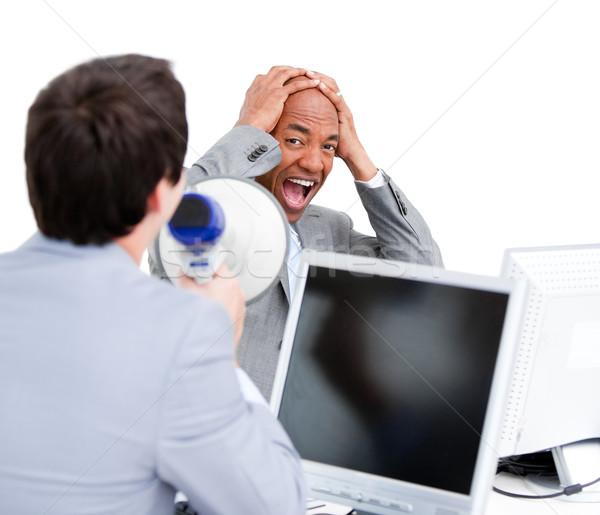 Stressed businessman yelling through a megaphone Stock photo © wavebreak_media