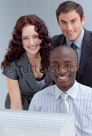 Self-assured male manager checking his employee's work  Stock photo © wavebreak_media
