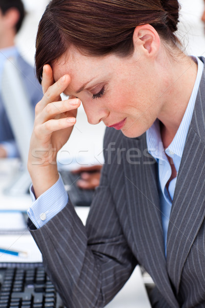 Attractive businesswoman suffering from a migraine Stock photo © wavebreak_media