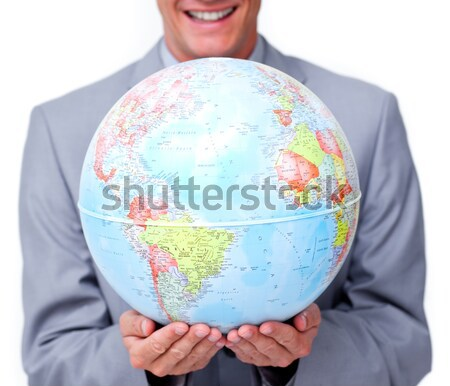 Fortunate businessman holding a terrestrial globe Stock photo © wavebreak_media