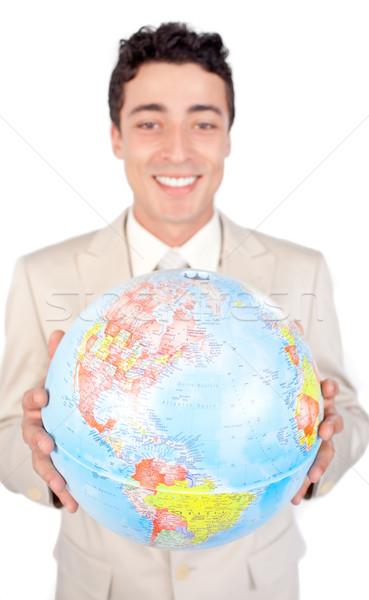 Assertive male executive holding a terrestrial globe  Stock photo © wavebreak_media