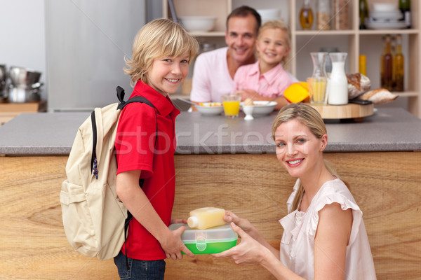 Attentive mother packing the school lunch to his son  Stock photo © wavebreak_media